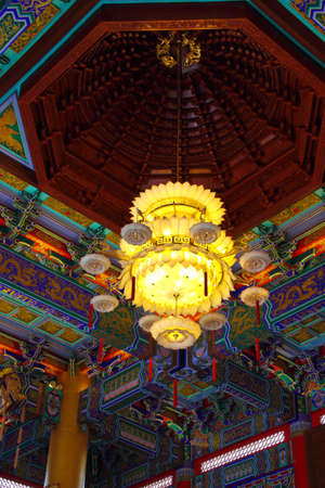 beautiful chinese lamp attached to ceiling, temple of thailand photo