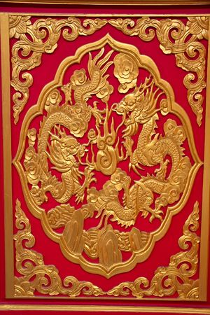 chinese dragons on red texture, temple in thailand