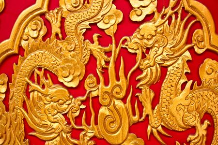 chinese dragons on red texture, temple in thailand photo