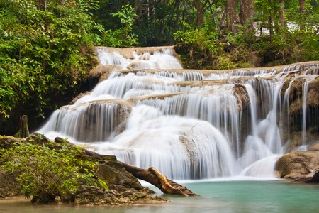 a beautiful waterfall and rainforest in kanchanaburi, thailand photo