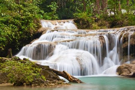 a beautiful waterfall and rainforest in kanchanaburi, thailand Stock Photo