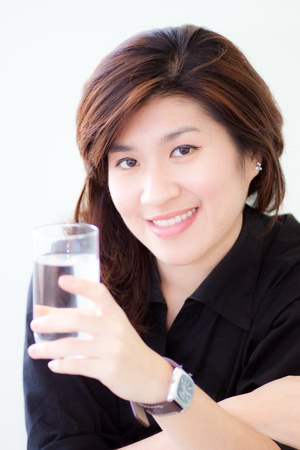 asian woman with a glass of water on white background