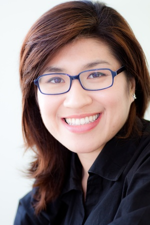 asian woman wearing black shirt with glasses on white background