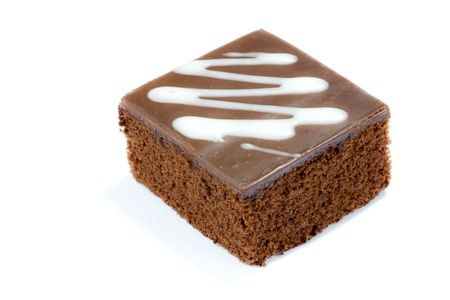 a piece of chocolate cake on white background