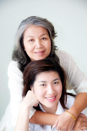 asian mother and daughter: two asian women enbracing Stock Photo