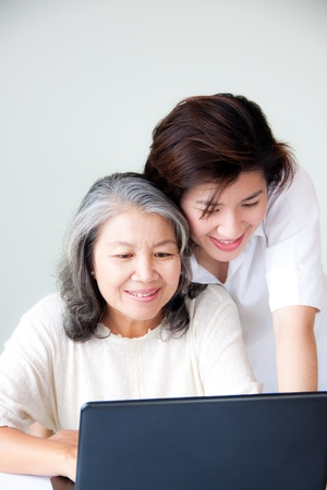 smiling two asian women with notebook Stock Photo