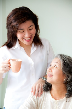 asian mother and daughter: smiling two asian women