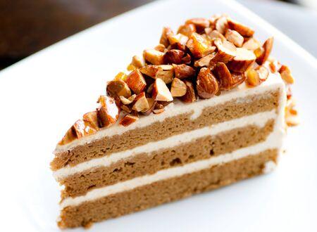coffee almond cake on white dish Stock Photo