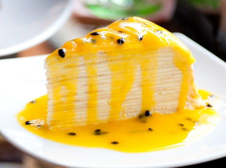 layers: passion fruits crepe cake on white dish Stock Photo