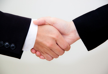 shakes hands: hand shaking on white background
