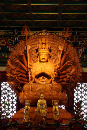 wooden buddha in dragon temple, thailand Stock Photo - 10711321