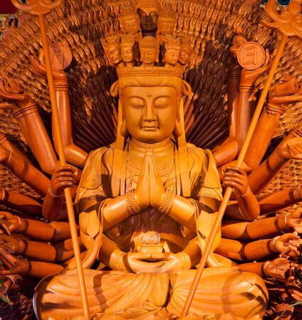 wooden buddha in dragon temple, thailand Stock Photo