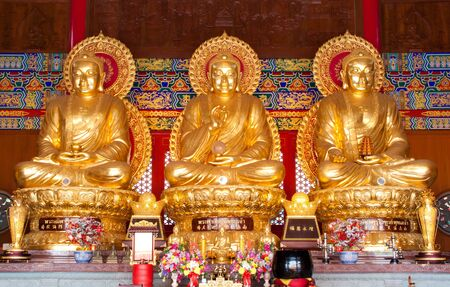 3 buddha statues in dragon temple, thailand Stock Photo