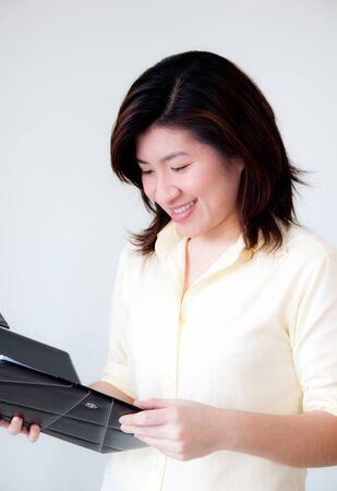 beautiful asian woman reading