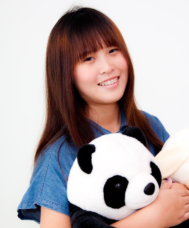 young asian woman playing with panda Stock Photo