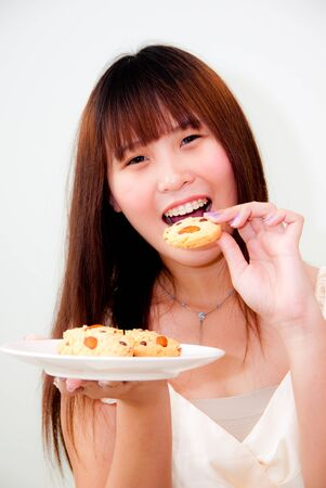 cute asian woman with cookies photo