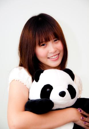 young asian woman playing with panda photo