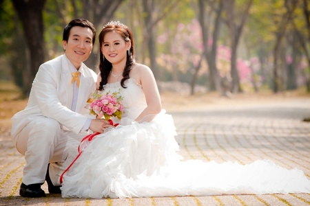 asian couple in wedding dress photo