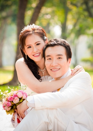 asian couple in wedding dress