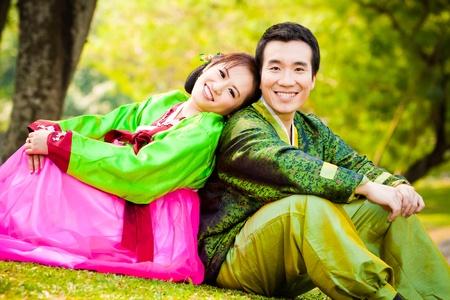 asian couple in wedding dress