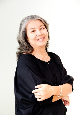 portrait of senior asian woman with arms folded photo