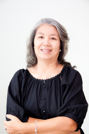 portrait of senior asian woman with arms folded