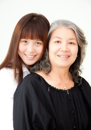 happy young asian woman hugs an elder woman photo
