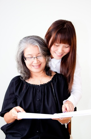 senior asian woman enjoy reading with her granddaughter  photo