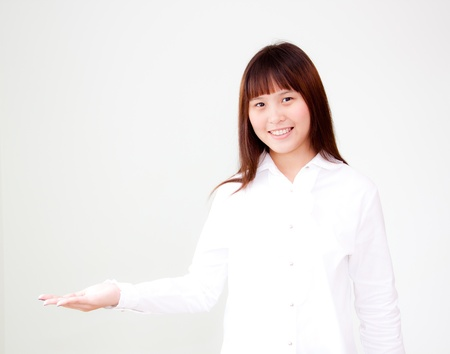 smiling cute asian woman present ing photo