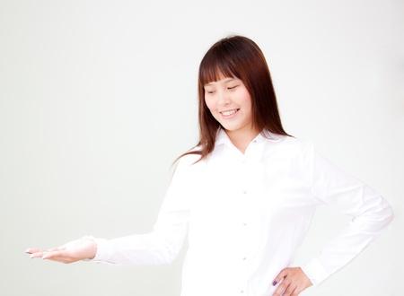 ing: smiling cute asian woman present ing Stock Photo
