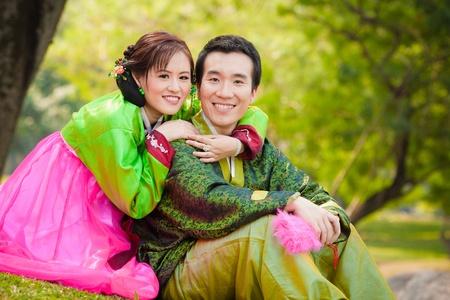Happy asian couple in korean wedding style photo
