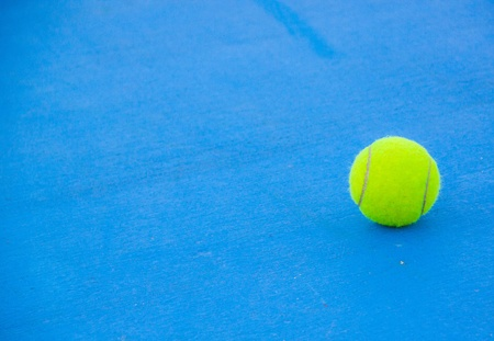 courts: tennis ball on blue hard court