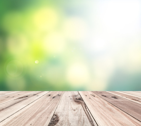 Old wooden floor in front of abstract blur color background