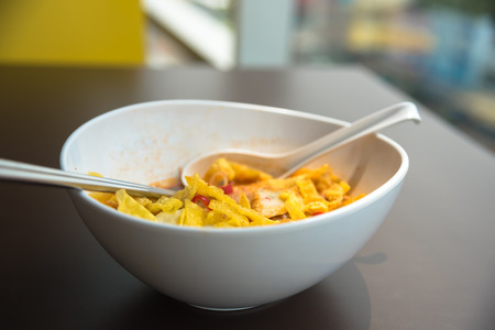 noodle fried dumplings greasy eggs in bowl
