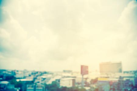blurred cityscape building sky cloud sunlight backgrounds,vintage color.