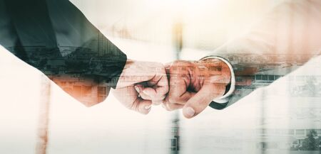 Fist bump collide agreement of two businesspeople, show strength teamwork, handshake negotiations finish together after good deal, double exposure, panoramic banner.