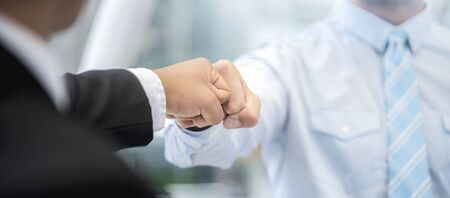 Fist bump collide agreement of two businessman, show strength teamwork, handshake negotiations finish together after good deal,panoramic banner. 스톡 콘텐츠