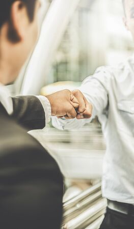 Fist bump collide agreement of two businessman, show strength teamwork, handshake negotiations finish together after good deal