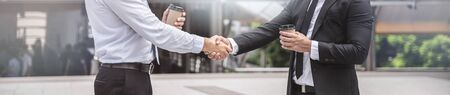 Businessmen handshake in the city, congratulation, cooperation, successful, panoramic banner