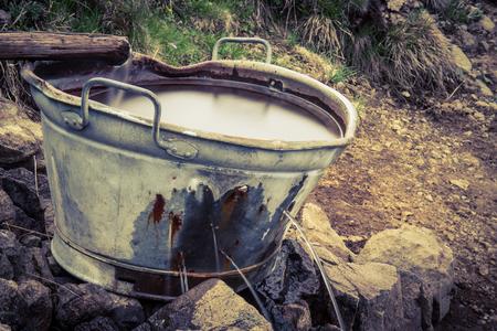 old water bowl Standard-Bild