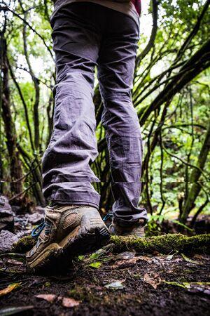 hiking boots on muddy ground Stock Photo
