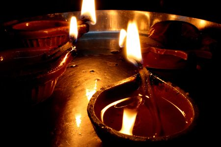 Traditional oil Lamps arranged in a metallic plate on the occasion of Diwali festival in India.