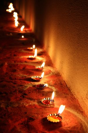 A background with a beautiful line of traditional lamps lit on the occasion of Diwali festival in India.