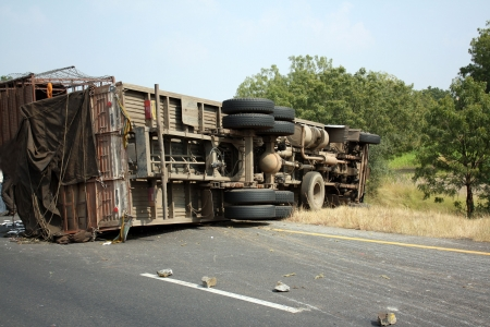 A view of an overturned truck on an highway in an accident.