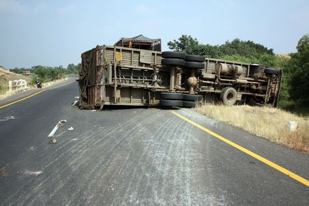 wheel truck: A view of an overturned truck on an highway in an accident.