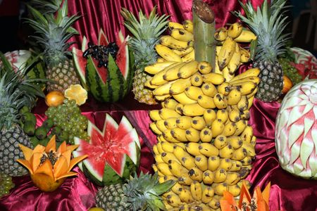 A background of arrangement of various tropical fruits at a dinner party. photo