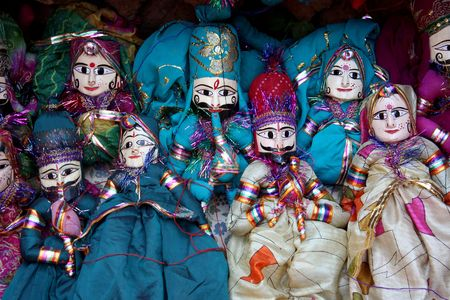 A background with a view of colorful Indian puppets in traditional designs used in Indian folk art. photo