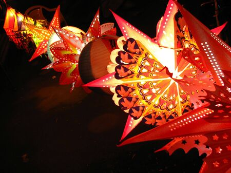A backgorund with a view of a line of beautifully designed colorful lanterns (also locally called as skylanters) decoration, lit of the occasion of Diwali  Christmas festival in India.