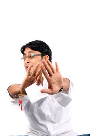 metaphorical: A metaphorical image of a young Indian man with a gesture Thats Enough, on a white studio background.