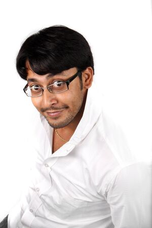 A young Indian guy in a funny pose and expression, on white studio background. Stock Photo - 5455621